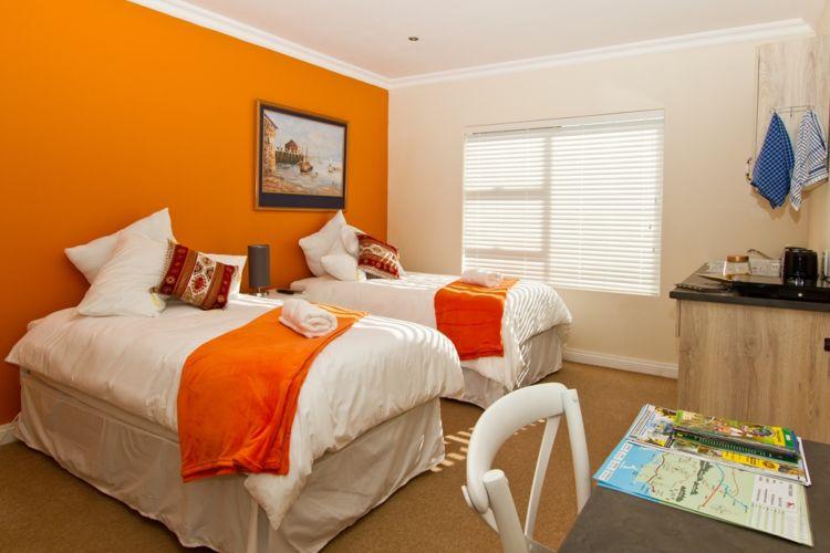 Orange room three quarter beds